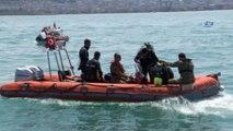 Batık gemiye dalıp Türk bayrağı açtılar