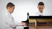 "Alex, a Mongolian American boy in Virginia, is playing a traditional Mongolian song Yunden Guuguu/""Юндэн Гөөгөө"" arranged by his piano teacher, composer, produc"