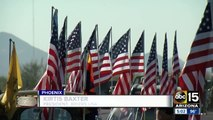 Valley group lines Veteran's National Memorial Cemetery entrance with hundreds of flags