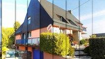 CENTRE VILLE DE CARHAIX : superbe maison d'architecte de 210 m² habitable sur 654m² de jardin clos