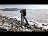 Stone age man - Adrian Gray balancing stones on Lyme Regis beach