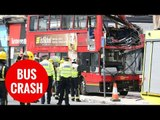 Two trapped after a double decker bus smashed into a shop