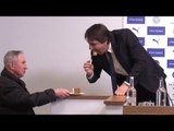 Chelsea Manager Antonio Conte Gobbles Some Cake Offered By A Journalist During Press Conference