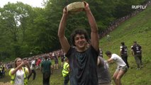 Crackers cheese-chasers plunge down hill in traditional race