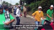 Relatives of volcano victims ignore police search suspension