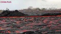 Lava from the eighth fissure of the Kilauea volcano flows towards the ocean as seen in Noni Farms, Kilauea on Hawaii's Big Island on June 15, 2018. Kilauea has