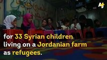 Syrian refugee children are attending a makeshift school in a tent on a Jordanian farm.