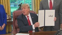 Trump signs executive order to reverse his immigration policy
