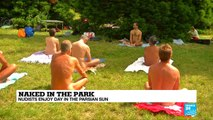 Paris: Naked in a park, Parisian nudists enjoy a hot day in the sun
