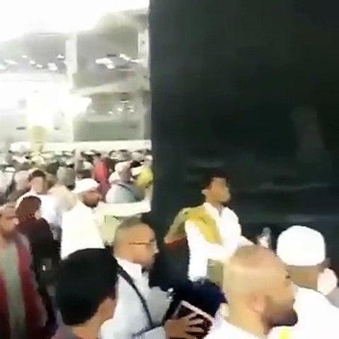 Man Throwing Petrol On Kaaba