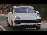 Porsche Cayenne Turbo Carrara White Metallic Driving on the road