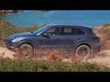 Porsche Cayenne Biskaya Blue Metallic Driving off road