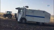 Polis ekipleri tarla yangınına TOMA ile müdahale etti
