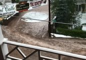 Road Becomes River as Floodwaters Cover Manitou Springs, Colorado