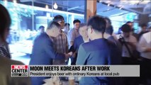 S. Korean President Moon Jae-in enjoys a cold glass of beer with ordinary Koreans at a downtown pub
