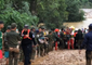 Thai Rescue Workers Help Victims of Laos Flooding Following Dam Collapse