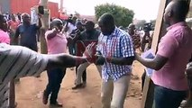 VIDEO: Bukooli Central MP and NRM Caucus Vice Chairperson Solomon Sirwanyi using pepper spray to chase away Bugiri Municipality voters who were trying to arrest