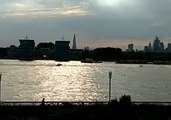 Police Boats Pursue Jet Skis Along the River Thames
