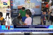 Alumnos del Centro Escolar Melania Morales reciben su merienda escolar, preparada de manos de sus propias madres ...