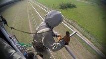 Ces ouvriers interviennent en hélicoptère sur des lignes électriques à haute tension
