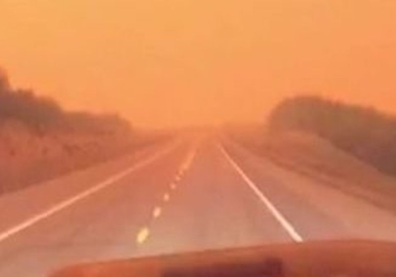 Truckers Drive Through Smoke Near Wildfire in Rural British Columbia