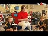 Anjing di Tasmania Bantu Anak Belajar Membaca