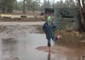 Woman Rejoices as Heavy Rains Drench Drought-Stricken Paddocks in Caroona