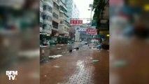 Des arbres pliés, des vitres cassées... un paysage de désolation à Hong-Kong après le passage du typhon Mangkhut