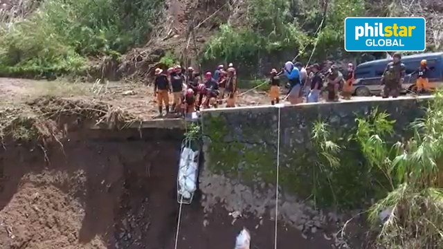 Authorities retrieve another body during a search, retrieval operation in Benguet