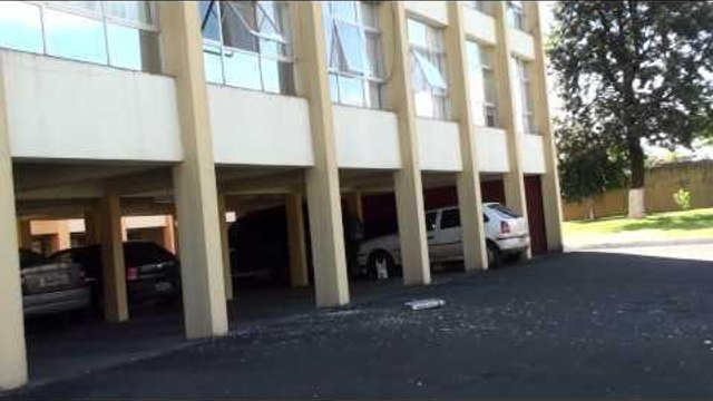 Guy Shatters Window While Throwing DVD Player From Building