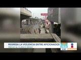 Aficionados de Monterrey y Tigres se agarran a golpes en la calle | Noticias con Zea