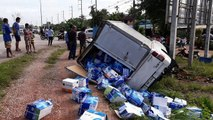 Woman's car flattened by out-of-control truck while waiting at junction