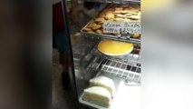 Una rata reina en el escaparate de una conocida pastelería