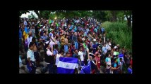 """Le Mexique entrouvre sa frontière à la """"caravane"""" de migrants"""