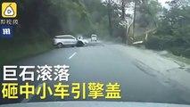 Un rocher tombe pile sur une voiture en marche... Pas de chance