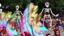 Giant skeletons dance in Mexico for Day of the Dead parade