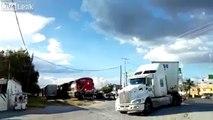 Ce camion ignore les klaxons d'un train... et se fait enfoncer au passage à niveau !