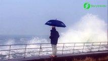 Parapluie VS grosse vague... Pas très efficace en pleine tempête