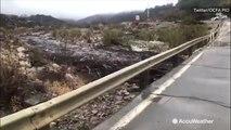 Rain and debris rush down hill off burn scar areas