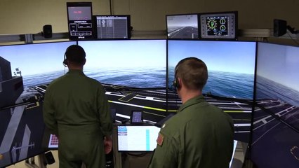 Aircraft carrier flight deck simulator in action