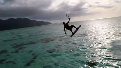 Parasail surfer jumps in front of overwater bungalow