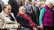 Touching moment Bob Dole was helped out of wheelchair to stand to pay respects to George H.W. Bush