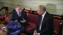 FIA President Jean Todt presents Vladimir Putin with a racing helmet