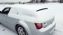 Jolie méthode pour déneiger sa voiture... Caisson de basse!!!!