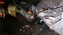 Carro atinge caçamba de entulho na Avenida Tancredo Neves