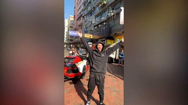 Entrepreneur throws money off a building in Hong Kong
