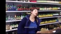 Had To Much Of Her Own Supply: Drunk Woman Selling Liquor Behind The Counter Of A Liquor Store