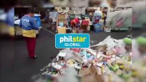 Street sweeper cleans up piles of trash left by Black Nazarene devotees at Quiapo Church