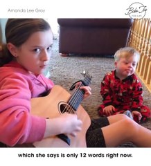 "Power of music: Girl sings ""You're My Sunshine"" to her Down Syndrome brother"