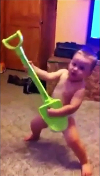 A baby born to be Guitar Hero!